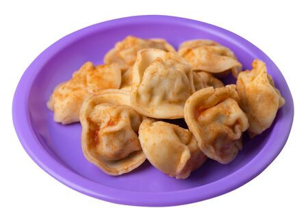 dumplings on a purple plate isolated on white background.