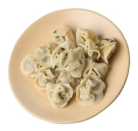 dumplings on a beige plate isolated on white background
