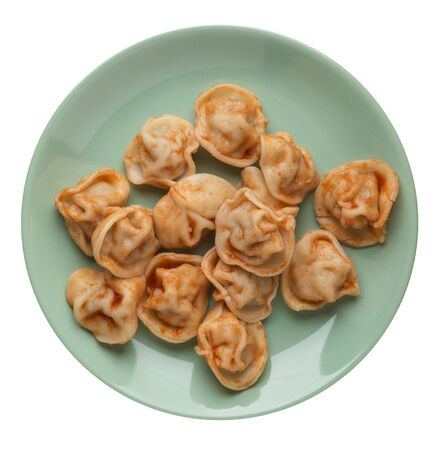 dumplings on a light green  plate isolated on white background.
