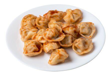 dumplings on a white plate isolated on white background.
