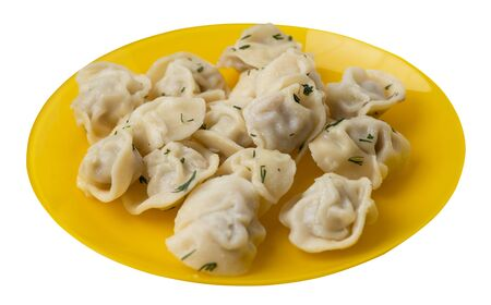 dumplings on a yellow plate isolated on white background