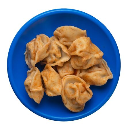 dumplings on a blue plate isolated on white background.