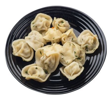 dumplings on a black plate isolated on white background