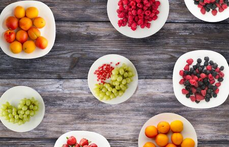 fruits on a plate. vegetarian food on wooden background. Archivio Fotografico