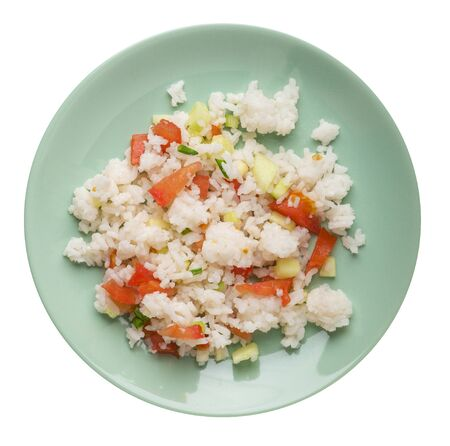 rice with vegetables on a light green  plate isolated on white background . rice with tomatoes, cucumbers and onions .healthy breakfast  rice top view
