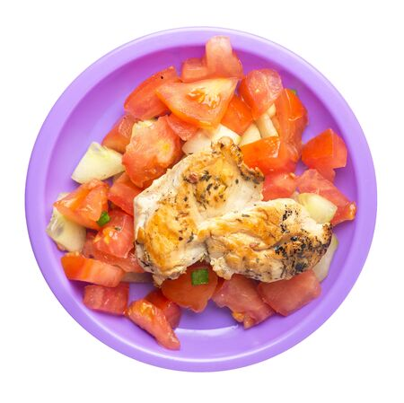 grilled chicken breast salad with tomato, cucumber and onion .grilled chicken breast on a purple plate isolated on white background. grilled chicken breast top view 写真素材