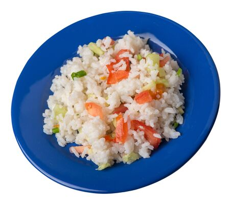 rice with vegetables on a plate isolated on white background . rice with tomatoes, cucumbers and onions .healthy breakfast  rice top side view