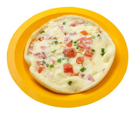 omelet with tomatoes and green onions on a yellow  plate isolated on white background.omelet with vegetables top side  view. healthy breakfast