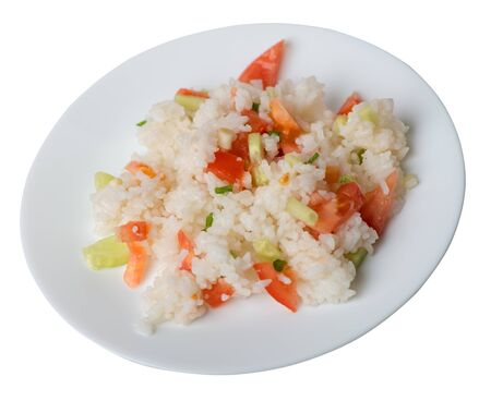 rice with vegetables on a white  plate isolated on white background . rice with tomatoes, cucumbers and onions .healthy breakfast  rice top side view 写真素材