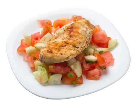 grilled chicken breast salad with tomato, cucumber and onion .grilled chicken breast on a white  plate isolated on white background. grilled chicken breast top side  view