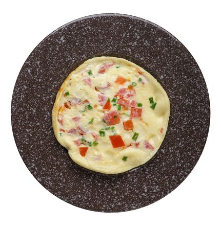 omelet with tomatoes and green onions on a brown with marble crumb plate isolated on white background.omelet with vegetables top view. healthy breakfast
