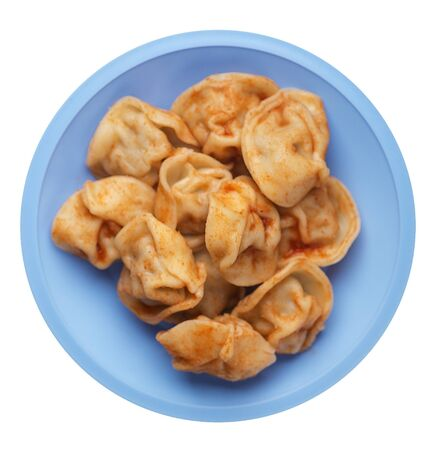 dumplings on a light blue plate isolated on white background. dumplings in tomato sauce. dumplings top view Stock fotó