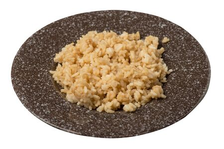 rice in soy sauce isolated on white background. rice in soy sauce on a brown with a marble crumb plate top side view . Standard-Bild