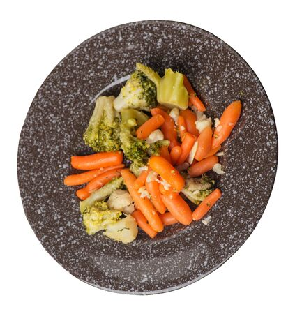 provencal vegetables on a brown with a marble crumb plate.grilled vegetables on a plate isolated on white background.broccoli and carrots on a plate top side  view.healthy vegetarian food