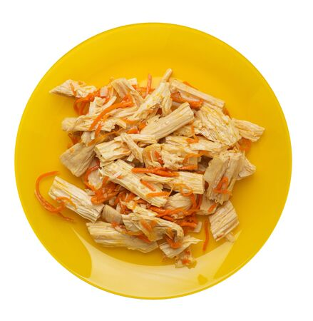 soy asparagus and carrot salad on a yellow  plate. soy asparagus isolated on white background. Asian food top view. vegetarian food Stok Fotoğraf