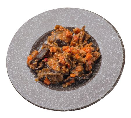 stewed zucchini with tomatoes and peppers on a brown with a marble crumb plate isolated on a white background. vegetarian food. healthy breakfast top side view