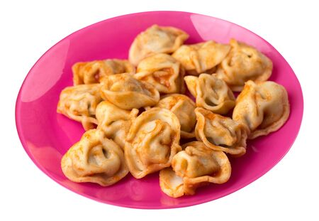 dumplings on a pink  plate isolated on white background. dumplings in tomato sauce. dumplings top side  view Stock fotó