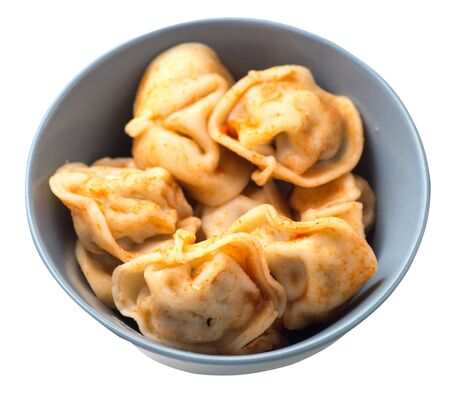 dumplings on a gray plate isolated on white background. dumplings in tomato sauce. dumplings top side view