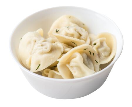 dumplings on a white plate isolated on white background .boiled dumplings.meat dumplings top side view .pelmeni with dill