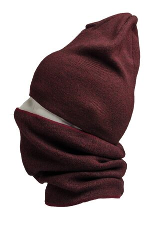 dark red hat and scarf isolated on white background.knitted set of hats and scarf.winter accessories side view Imagens