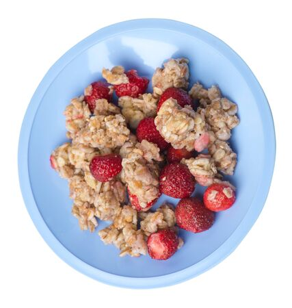 muesli with strawberries on a light blue  plate isolated on white background.healthy breakfast top side view.diet food on a plate. 写真素材