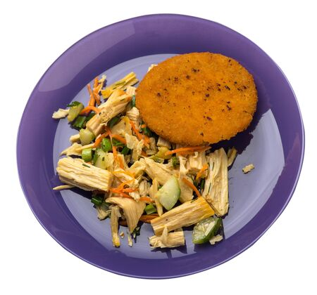 fishcake with soy asparagus and carrots, cucumbers and dilll.  fish cutlet on a purple plate isolated.fish cutlet with vegetables top side view