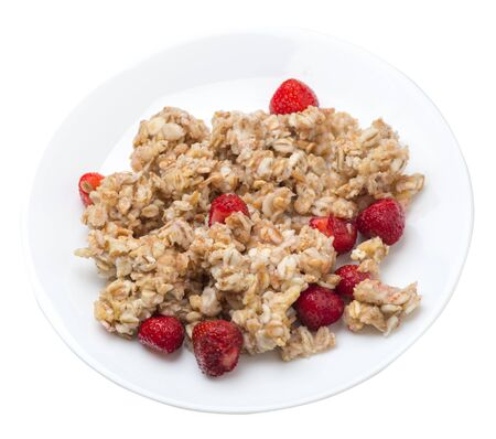 muesli with strawberries on a white plate isolated on white background.healthy breakfast top view.diet food on a plate.