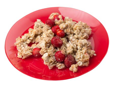 muesli with strawberries on a red  plate isolated on white background.healthy breakfast top side view.diet food on a plate. 写真素材