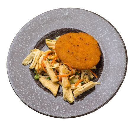 fishcake with soy asparagus and carrots, cucumbers and dilll.  fish cutlet on a brown with a marble crumb  plate isolated.fish cutlet with vegetables top side view Stockfoto