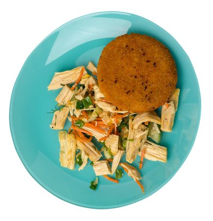 fishcake with soy asparagus and carrots, cucumbers and dilll.  fish cutlet on a turquoise plate isolated.fish cutlet with vegetables top side view Stockfoto
