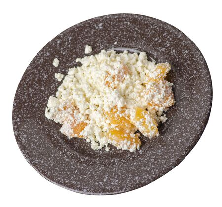cottage cheese with peaches on a brown with a marble crumb plate isolated on white background. cottage cheese top side view. healthy breakfast