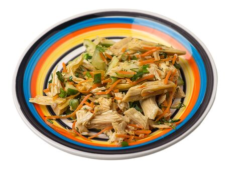 salad with soy asparagus and carrots, cucumbers and dumplings on a multicolored plate. vegetarian soy salad on a plate isolated on white background. healthy eating top sdie view. Foto de archivo - 129862247