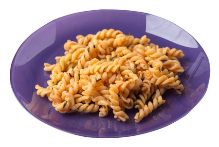 pasta on a purple plate isolated on white background. pasta in tomato sauce with dill. pasta top side  view Foto de archivo - 129862248