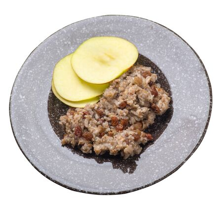 rye flakes with raisins and apples on a   brown with a marble crumb  plate. rage flakes isolated on white background. healthy breakfast top side view Stock fotó