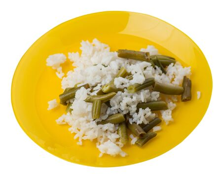 rice with asparagus beans on a yellow  plate isolated  on white background .healthy food . vegetarian food top side view. Asian cuisine Foto de archivo - 129862451