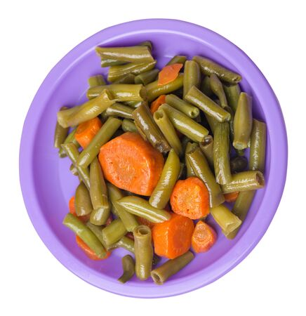 green beans with garlicand carrots  on a white purple isolated on white background.green beans with carrot top side view. healthy vegetarian food Foto de archivo - 129862542
