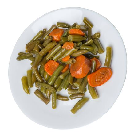 green beans with garlicand carrots  on a white  plate isolated on white background.green beans with carrot top side view. healthy vegetarian food Foto de archivo - 129862545