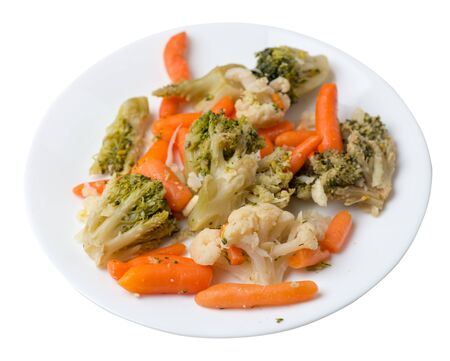 provencal vegetables on a white plate.grilled vegetables on a plate isolated on white background.broccoli and carrots on a plate top view.healthy vegetarian food Foto de archivo - 129862561