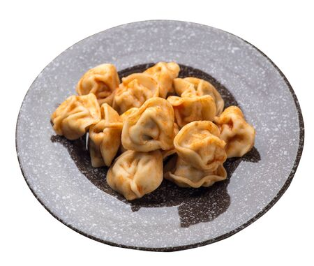 dumplings on a  brown with a marble crumb plate isolated on white background. dumplings in tomato sauce. dumplings top side view Foto de archivo - 129862593