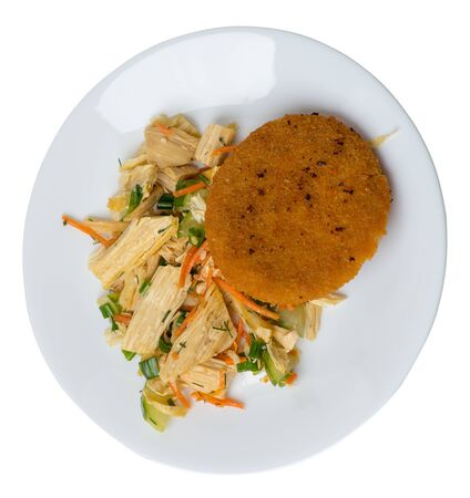 fishcake with soy asparagus and carrots, cucumbers and dilll.  fish cutlet on a white  plate isolated.fish cutlet with vegetables top side view Foto de archivo - 129862604
