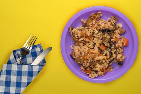 rice on a purple plate on a yellow background. white rice top view. Asian cuisine .vegetarian food Stok Fotoğraf