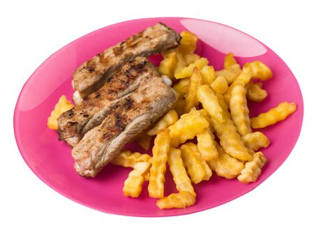 grilled pork ribs with french fries on a pink plate. pork ribs with french fries on a white background. ribs with potatoes top side view