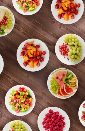 Fruit diet. Fruits on a plate on a wooden background. Healthy food . Stock Photo