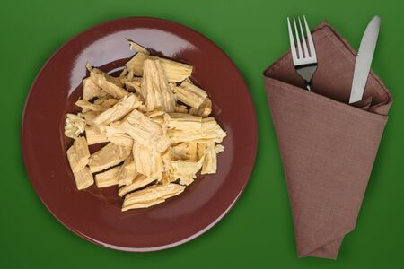 soy asparagus noodles on a brown plate on a dark green background. healthy food . Asian food. soy asparagus noodles top view.