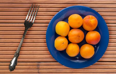 fruits on a blue  plate on a orange  wooden background .fruits on a plate top view.healthy eating. vegetarian food