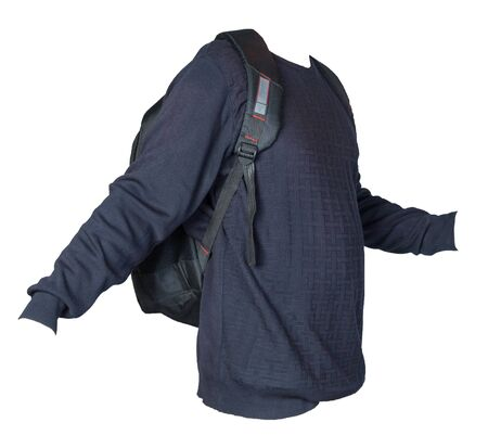 black backpack dressed in a knitted blue sweater isolated on a white background. backpack and male sweater front  sdie view Stockfoto