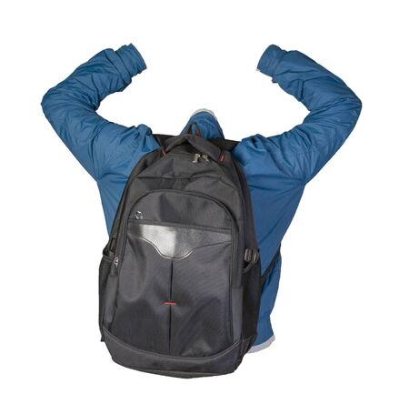 black backpack dressed in a blue jacket isolated on a white background. back view backpack and jacket Standard-Bild