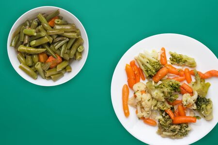 Provencal vegetables on a white plate. fried vegetables on a plate a colored background. Vegetarian food. healthy food top view.flat lay