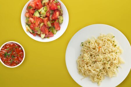 vermicelli on a white plate. vermicelli on a yellow  background top view. Asian food.flat lay