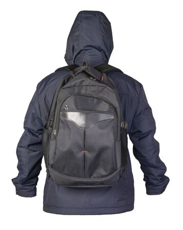 black backpack dressed in a blue jacket isolated on a white background. rear view of a backpack and jacket 写真素材